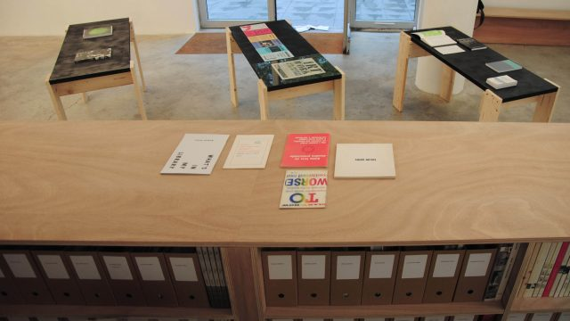 The practical function of 12 networked publications with 4 books, 2 posters, 1 chart